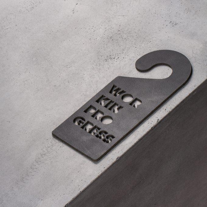 door-hanger-work-in-progress-black-leather-gifts